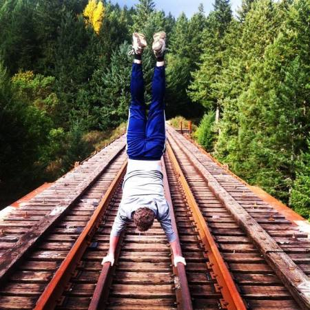 Doing a handstand on the trestle near Victoria